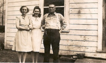 Maternal grandmother (c) with my great-grandparents.